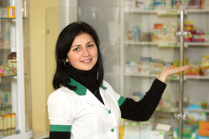 pharmacist woman standing in pharmacy